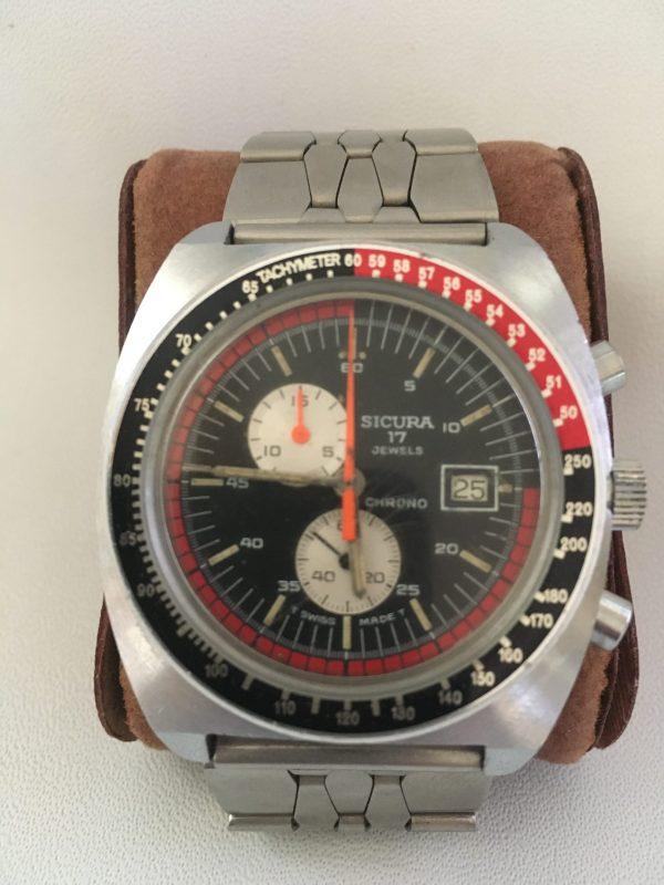 La brocante vintage french art à Castres met en vente cette superbe montre vintage : Sicura chrono homme 1960/1969 bracelet d'origine boîtier 41mm très bon état de marche et en excellent état.
